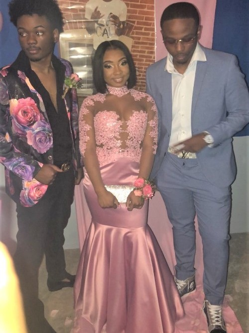 Pink Gown with Suited Men